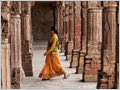 A young woman walking in Qutab Minar complex, commissioned by Qutbuddin Aibak, the first Muslim Sultan of Delhi.