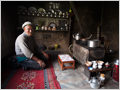 A farmer preparing tea in his traditional Ladakhi kitchen.