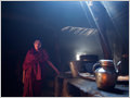 One of the young monks in the smoky kitchen of Lingshed gompa (monastery), Lingshed, Ladakh, Jammu and Kashmir, India.