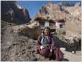 An old woman in front of her house located in high mountains of Ladakh, Lingshed, Ladakh, Jammu and Kashmir, India
