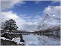 Mt. Innerdalstårnet reflection in Innerdalsvatna lake, Innerdalen, Møre og Romsdal, Norway.