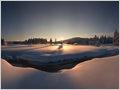 Sunrise at Bloščica stream after a fresh snowfall, plateau Bloke, Notranjska region, Slovenia.