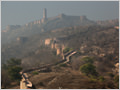 Misty morning light over Amber Fort near Jaipur, Rajasthan, India.