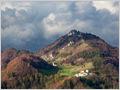 Threatening clouds over Mt. Polhograjska Grmada and village Setnica, Polhograjsko hribovje, Slovenia.