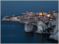 Located on a cliff, high above the sea, Bonifacio is a town at the southern tip of the island of Corsica.