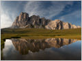 Reflection of Lastoni di Formin massif in calm waters of Lago delle Baste, Dolomiti Ampezzane, Italy.