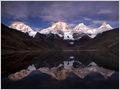 Siula Grande, Yerupaja, Yerupaja Chico, Jirishanca and Niñashanca (from L to R) reflecting in Laguna Carhuacocha, Cordillera Huayhuash, Peru.