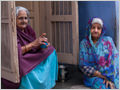 A portrait of two old women sitting on the streets of Jodhpur, Rajasthan, India.