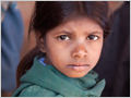 A sad expression on the face of a school girl from a village between Sayra and Kumbhalgarh fort, Rajasthan, India.