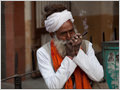 An old man smoking chillum on the streets of Pali, Rajasthan, India.