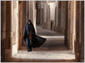 A woman wearing chador in the old bazaar of Naein city, Iran.