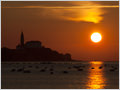 A silhouette of the church of Saint George (sl. Sveti Jurij) at sunset, Piran, Slovenia.
