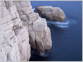 Limestone cliffs above the blue waters of Calanques de Cassis, Cassis, France.