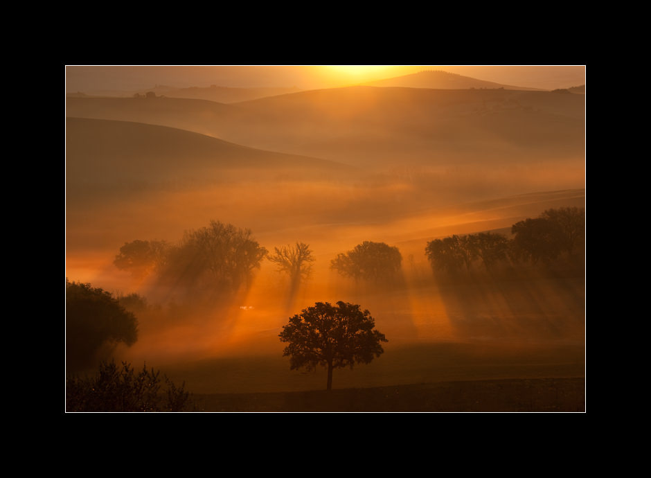 A spectacular sunrise over the misty hills near San Quirico D'Orcia, Tuscany, Italy.