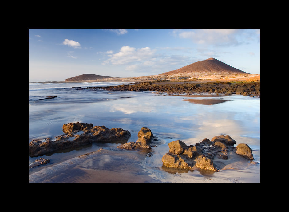 A sandy beach near La Montaña Roja (The Red Mountain), a volcanic cone that is a protected natural reserve, Medano, island of Tenerife, Canary islands, Spain.
