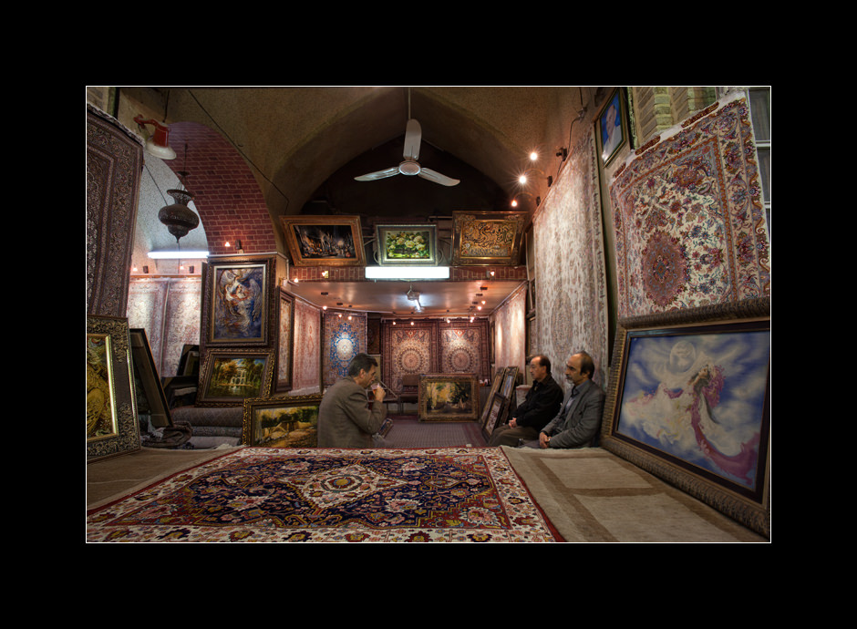 Three men enjoying the tea in one of the many Persian rug shops located inside Vakil bazaar, Shiraz, Iran.