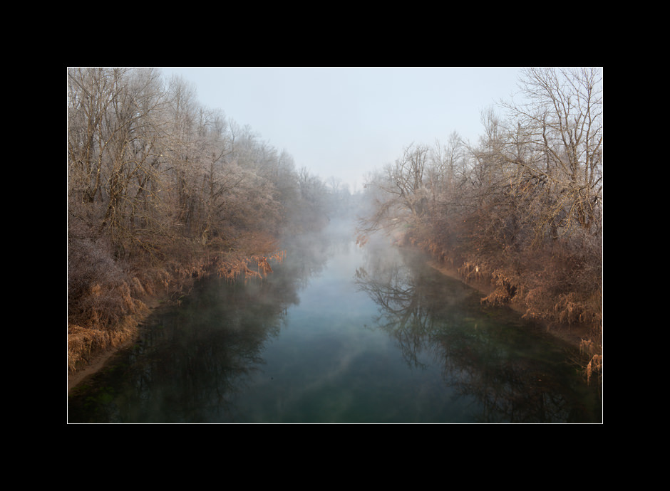 River Ljubljanica with it's calm waters near the town of Vrhnika, Slovenia.